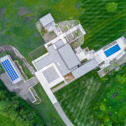 A drone view of the home, with garage aerial photography, bird's eye view, land lot, urban design, green