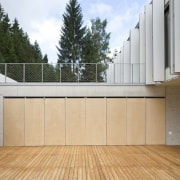These panels slide back to reveal the home architecture, daylighting, facade, house, property, real estate, gray