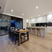 There's ample room for entertaining in the kitchen countertop, floor, flooring, interior design, kitchen, property, real estate, wood flooring, gray