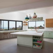 The open kitchen faces out to the sea, architecture, interior design, kitchen, real estate, gray