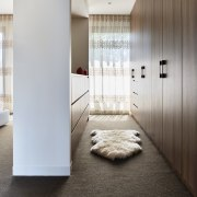 An open wardrobe expands the utility of the architecture, floor, flooring, home, interior design, room, gray, black