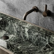 A closer view of the bathroom fittings and black and white, granite, water, wood, gray, black