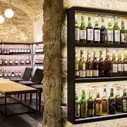 This new whiskey bar takes advantage of a alcoholic beverage, distilled beverage, drink, liquor store, black