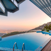 Another infinity pool with an unbeatable view architecture, estate, leisure, property, real estate, reflection, resort, sea, sky, swimming pool, vacation, water, gray