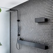 A charcoal faucet and matching shelves complement the architecture, house, wall, window, gray, white