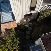 An elevated view of the courtyard backyard, balcony, courtyard, facade, home, house, neighbourhood, outdoor structure, plant, property, real estate, residential area, roof, tree, window, yard, black