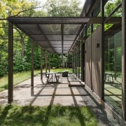 The sheltered outdoor area diffuses the sun architecture, house, outdoor structure, pavilion, plant, real estate, tree, walkway