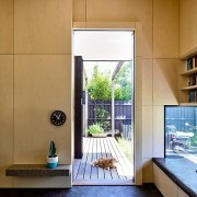 A low window sits just above this seat architecture, door, home, house, interior design, real estate, room, window, brown