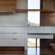 This window runs down to the floor – architecture, cabinetry, chest of drawers, countertop, furniture, hardwood, interior design, kitchen, wood, brown, white