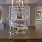 Looking across the dining table ceiling, chandelier, dining room, furniture, home, interior design, light fixture, living room, room, table, wall, gray, brown