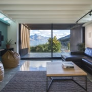 Arrowtown-based Bennie Builders was the only Southern Lakes ceiling, daylighting, house, interior design, living room, real estate, room, window, gray, black