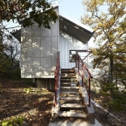 The entrance is elevated architecture, cottage, home, house, log cabin, path, property, real estate, trail, tree