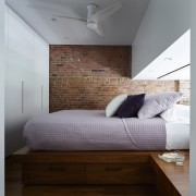 Light from the lounge illuminates the bedroom. There's architecture, bed, bed frame, bedroom, ceiling, daylighting, floor, furniture, home, interior design, room, wall, wood, wood flooring, gray