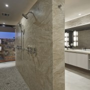 No shortage of shower options in this bathroom architecture, ceiling, countertop, floor, flooring, interior design, lobby, real estate, tile, wall, gray