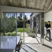 Most walls facing the courtyard/garden have been replaced architecture, courtyard, home, house, interior design, real estate, window, gray, black