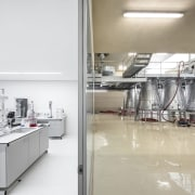The winery itself is clean and clinical countertop, floor, flooring, interior design, kitchen, product design, gray, white