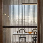 Translucent curtains filter the light in this dining architecture, ceiling, daylighting, interior design, lobby, wall, window, window covering, gray, black