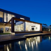 The pool is just a step away from architecture, estate, facade, home, house, lighting, property, real estate, reflection, residential area, roof, sky, swimming pool, villa, window, blue