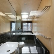 A bathroom of contrasts, this space features black architecture, interior design, real estate, brown