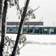In the snow, the buildings appears like the architecture, freezing, home, house, ice, snow, tree, winter, white