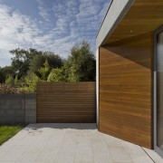 Wood accents reflect the forested surroundings architecture, door, facade, home, house, real estate, siding, wood, brown, gray