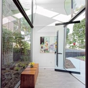 The entrance hall is essentially a large glass architecture, ceiling, daylighting, floor, flooring, home, house, interior design, real estate, window, white, gray