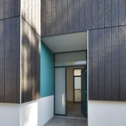 Touches of blue line this entryway architecture, building, daylighting, facade, house, real estate, gray