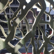 Newcastle Courthouse – Cox Architecture iron, metal, pattern, spoke, wheel, black