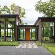 The entrance hall sits between two larger volumes architecture, estate, facade, home, house, property, real estate