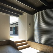 A covered water tank sits out of the architecture, ceiling, daylighting, house, interior design, lobby, structure, black, gray