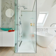 The shower divides the bathtub and floating vanity angle, bathroom, interior design, plumbing fixture, product design, room, tap, white