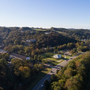 Barrel house aerial photography, bird's eye view, city, hill, panorama, photography, residential area, sky, suburb, tree, village, black