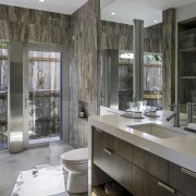 The bathroom opens out to the side of bathroom, countertop, floor, home, interior design, room, sink, gray, black