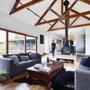 Exposed beams harken back to the home's past beam, ceiling, daylighting, floor, hardwood, home, house, interior design, living room, loft, room, wood, white