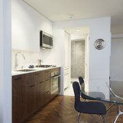 The fridge sits adjacent to the bathroom area apartment, architecture, ceiling, daylighting, floor, flooring, home, house, interior design, kitchen, real estate, room, wood, wood flooring, gray, brown