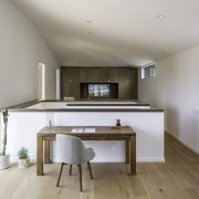 Not all home offices require a dedicated space. architecture, floor, home, house, interior design, kitchen, real estate, room, gray