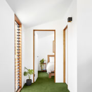 Green floors echo the outdoors architecture, door, home, house, interior design, real estate, window, white