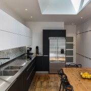 Looking side on, it's a remarkably well-contained space architecture, countertop, floor, flooring, interior design, kitchen, real estate, room, gray