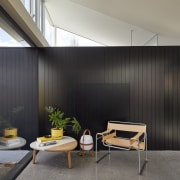 The black box stands in contrast to the architecture, house, interior design, real estate, wall, black, gray