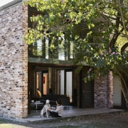 It's clear the renovation respects the original structure architecture, cottage, courtyard, estate, facade, home, house, outdoor structure, property, real estate, residential area, tree, black, gray