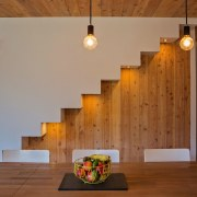 Wood contrasts with white walls architecture, ceiling, floor, flooring, hardwood, home, house, interior design, light fixture, lighting, stairs, wall, wood, brown, gray