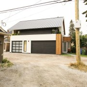 The home manages to blend into the neighbourhood estate, facade, home, house, property, real estate, residential area, siding, white