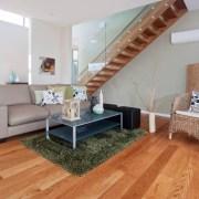 View the home floor, flooring, furniture, hardwood, home, interior design, laminate flooring, living room, property, real estate, room, wall, wood, wood flooring, gray