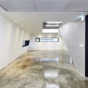 The 925 Building ceiling, daylighting, floor, flooring, interior design, lobby, property, real estate, wood flooring, gray, white