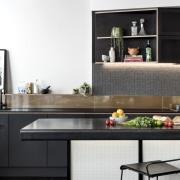 Recessed lights highlight the splashback countertop, cuisine classique, furniture, home appliance, interior design, kitchen, product design, table, white, black