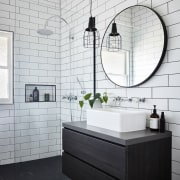 A circular mirror draws the eye, while New bathroom, bathroom accessory, bathroom cabinet, black and white, ceramic, floor, flooring, home, interior design, plumbing fixture, product, product design, room, sink, tap, tile, wall, white, black