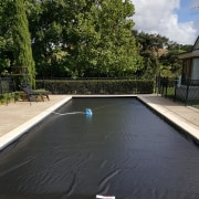 Coverstar Eclipse Auto Pool Covers are distributed here backyard, estate, leisure, outdoor structure, property, real estate, swimming pool, water, black