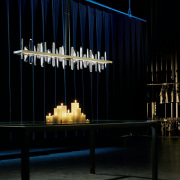 The Solitude is a modern take on the chandelier, darkness, light, light fixture, lighting, stage, black