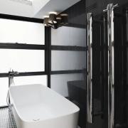 Not over-sized cabinet handles but rather heated towel bathroom, floor, interior design, plumbing fixture, room, black, white