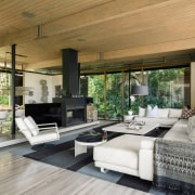 The open living space looks out to greenery home, house, interior design, living room, patio, real estate, gray, brown